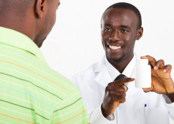 pharmacist assisting young man